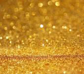 Abstract gold background with copy space . gliiter bokeh lights — Stock Photo