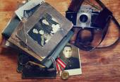Top view of vintage camera, old pictures and war madal. historic — Stock Photo
