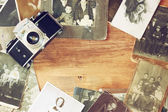 Top view of old camera, antique photographs — Stock Photo