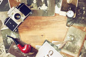 Top view of old camera, antique photographs and old pocket clock — Stock Photo