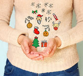 Young woman hands in cupped shape showing various colorful christmas icons — Stock Photo