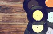 Top view of records over wooden table — Stock Photo