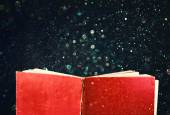 Open red book and glowing glittering lights — ストック写真