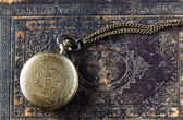 Macro image of old vintage pocket watch on old book. top view — Stock Photo