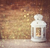 Vintage Lantern on wooden table and glitter lights background. filtered image — Stok fotoğraf