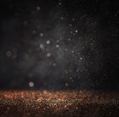 Dark glitter vintage lights background. light gold and black. defocused. — Foto Stock