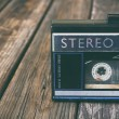 Old portable cassette player on a wooden background. image is instagram style filtered — Stock Photo #58567387