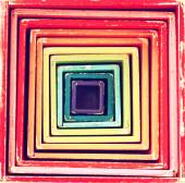 Picture of retro multicolor boxes toy that forms into geometrical square pattern — Stock Photo