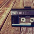 Old portable cassette player on a wooden background. image is instagram style filtered — Stock Photo #58653787