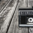 Black and white image of Old portable cassette player on a wooden background. — Stock Photo #58653801