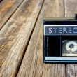 Old portable cassette player on a wooden background. image is instagram style filtered — Stock Photo #58653831
