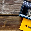 Old portable cassette player on a wooden background. image is instagram style filtered — Stock Photo #58654553