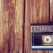 Old portable cassette player on a wooden background. image is instagram style filtered — Stock Photo #58654601