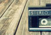 Old portable cassette player on a wooden background. image is instagram style filtered — ストック写真