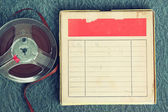 Top view of  old sound recording tape, reel to reel type and box with room for text. filtered image — Stock Photo
