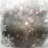 Glitter vintage lights background. light gold and black. with snowflake overlay . abstract background — Stock Photo