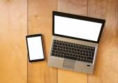 Top view of tablet device and laptop with blank screen ready for mock up — Stock Photo