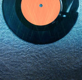 Top view of record over textured background and glitter lights — Foto de Stock