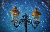 Picture of an antique street lamp against night sky. vintage filtered image and bokeh lights. — Stock Photo