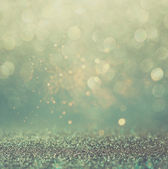Glitter vintage lights background. gold, silver, blue and black. de-focused. — Stock Photo