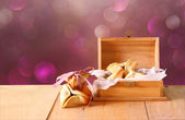 Hamantaschen cookies or hamans ears and mask for Purim celebration (jewish holiday) and glitter background — Stock Photo