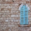 Old house's wall from jerusalem stone and old blue iron shutters — Stock Photo #61956109