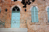 Old house's wall from jerusalem stone with old blue balcony. — Stock Photo