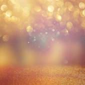 Abstract background of golden bokeh lights. — Stock Photo