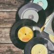 Close up image of old records over wooden table , image is retro filtered . — Stock Photo #62426707