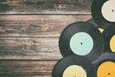 Close up image of old records over wooden table , image is retro filtered . — Stock Photo