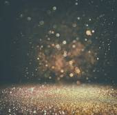 Glitter vintage lights background. light gold and black. defocused. — Stock Photo