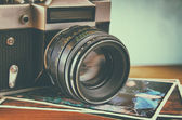Close up photo of old camera lens over wooden table. image is retro filtered. selective focus — Stock Photo