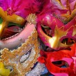 Top view of colorful Venetian masquerade masks. retro filtered image — Stock Photo #63791003