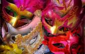 Top view of colorful Venetian masquerade masks. retro filtered image — Stock Photo