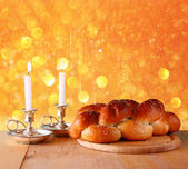 Sabbath image. challah bread and candelas on wooden table. glitter overlay — Stock Photo