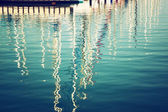 Reflection in water boats. vintage filtered image — Stock Photo