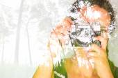 Double exposure image of young girl holding old camera and nature background — Stock Photo