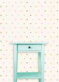 Vintage mint wooden chest drawer near vintage dots wall — Stock Photo
