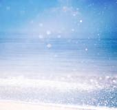 Background of blurred beach and sea waves with bokeh lights, vintage filter. — Stock Photo