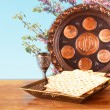 Passover background. wine and matzoh (jewish passover bread) on wooden table — Stock Photo #67852763