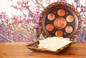 Passover background. wine and matzoh (jewish passover bread) on wooden table — Stock Photo