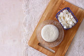 Top view of greek cheese and bulgarian cheese on wooden table over wooden textured background. Symbols of jewish holiday - Shavuot — Stockfoto