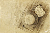 Image of greek cheese and bulgarian cheese on wooden table over wooden textured background. Symbols of jewish holiday - Shavuot. Black and white style photo. — Stockfoto