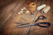 Vintage Background with sewing tools and sewing kit over wooden textured background — Foto Stock