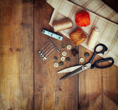 Vintage Background with sewing tools and sewing kit over wooden textured background — ストック写真