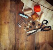 Vintage Background with sewing tools and sewing kit over wooden textured background — Stok fotoğraf