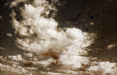 Sepia toned image of clouds in te sky. image is textured with paper texture and stains, vintage look style — Stock Photo