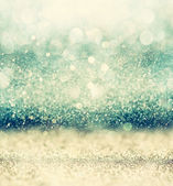 キラキラ ビンテージ ライト背景光バースト。銀、青と白。逆に焦点を当ててください。. — ストック写真