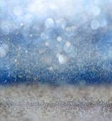 Glitter vintage lights background with light burst . silver, blue and white. de-focused. — Stock Photo
