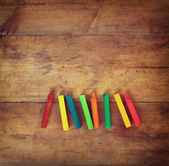 Image of various colorful crayons on wooden table — Stock Photo